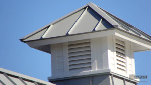 Gray aluminum cupola on metal roof