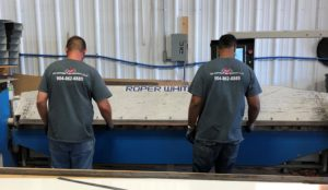 Workers with AMF logo on backs of shirt